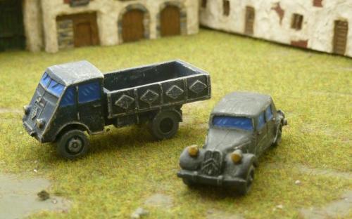 French civilian truck (dark blue) and vehicle (black)