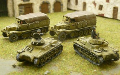 Afrika Korps half tracks and light tanks